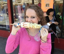 Hannah enjoying some elote (corn)