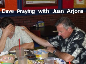 Dave praying with Juan Arjona