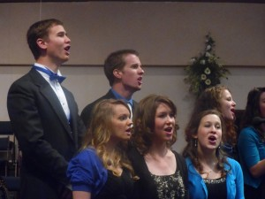 Hannah and friends singing during her graduation ceremony