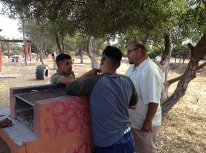 Pastor Leo (far right) & Luis sharing with Marvin