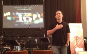 Pastor Stephen Phelan leading worship