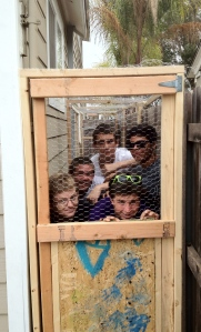 Bob Bjerkaas on the left with his guys in the chicken coop