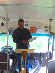 Pastor Juvenal Gonzalez on the mobile church bus