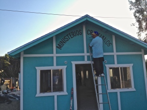 Painting the Sign on the Church