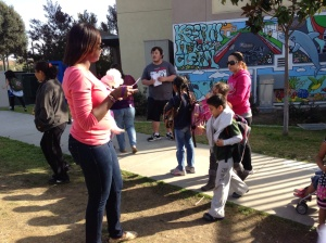 Handing out flyers in front of Fay Elementary school