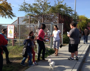 Shelonda & Josh handing out flyers with Daisy the evangelistic dog!