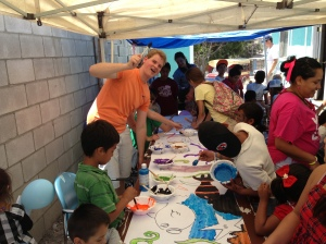 Jonathan having some fun helping the children paint a mural