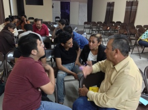 Pastor Mauro and his wife in a small group discussion