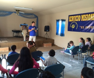Christian Castro teaching a Bible Story for the children