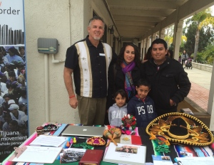 Dave at our missions table with Pastor Abraham and his wife Martha and their two children