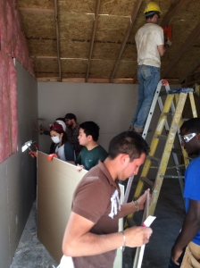 The group working hard to finish up the house