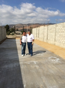 Pastor Ivan Casados with Pastor Daniel Nuñez on the new church's foundation