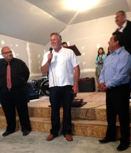 Dave sharing some words of encouragement with Ivan and Rocio during the inaugural service