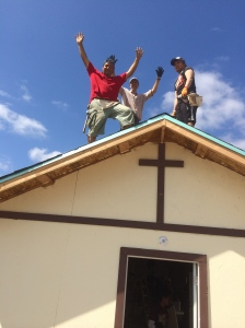 Celebrating finishing the roof on the church