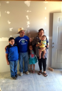 Jesus and Dulce and their family inside their new home