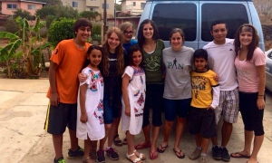 The youth at the van with some of their young friends  that they made during the week