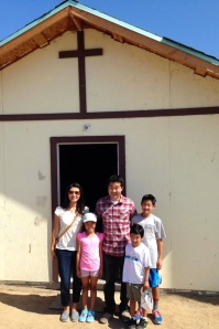 Paul and Linda Kim and family standing in front of the last church we helped build - the Lo Mejor del Trigo Church in Ribera del Bosque