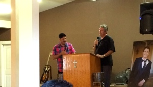 Scott Griffiths sharing at the memorial service for his son, Jacob. Turi Nuñez translated for Scott