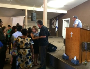 The people of Lo Mejor del Trigo comforting Scott and Susan after the service