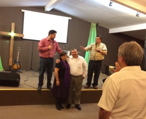 Praying for Pastor Daniel Nuñez and Yolanda at Lo Mejor del Trigo