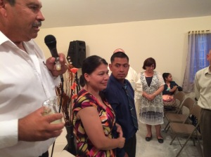 Pastor Daniel anointing Victor and Sol as they begin the ministry in Plan Libertador
