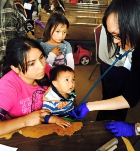 Nurse Practitioners, Patricia Lee caring for one of the little patients
