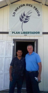 Dave with Pastor Victor in front of the church