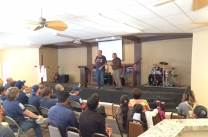 Scott Griffiths and pastor Daniel Nuñez sharing during the service