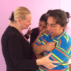 Dawn ministering to two women through prayer