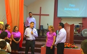 Jaime & Valentina on the far right receiving a plaque of recognition for their 7 years of ministry at the church