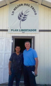 Dave & Pastor Victor Bravo in front of the church