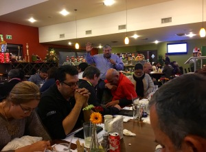 Pastor Daniel Nuñez praying for all the pastors and leaders of LMT