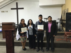 Rosa and her son, Mauro receiving their certificate from Jose Juan and Jeinny for completing the course