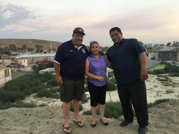 Pastor Daniel Nuñez with Arturo Vasquez and his wife on the property for MT's church plant #28!