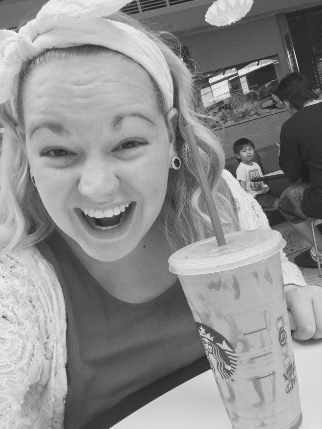 Hannah celebrating the good news with her favorite Starbucks drink!