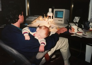 I like this shot of me working at night on my Mac with my son sleeping. The Mac dates me - it was one of the first models that came out in the late 80's.