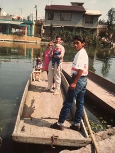 Enjoying a ride on a canoe with Armando Cisneros in Xochimilco