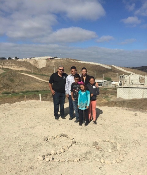 Pastor Daniel Nuñez with Pastor Obed Lares & Cesiah and their three children on the land where the church is being built
