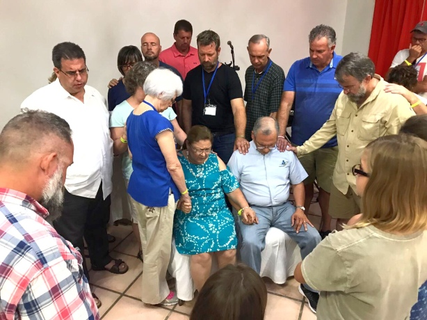 Coming together to pray for one another - Praying for Pastor Rafael Rodriquez and his wife, Martha