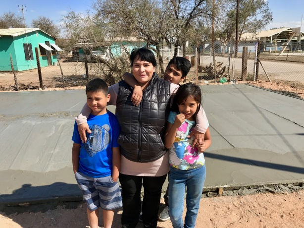 Cristina with her three children - she prayed for 3 years for this church!