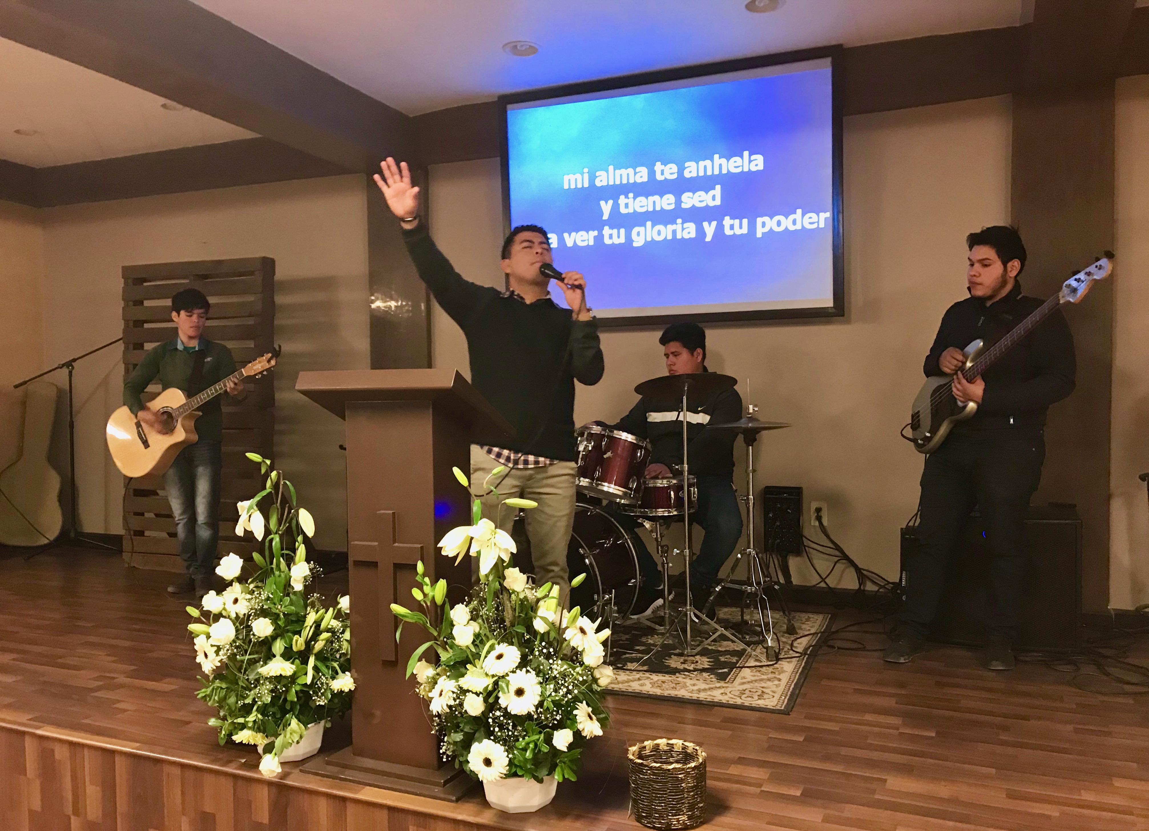 Pastor Abraham Velazquez leading worship