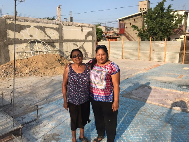 These two ladies, Alicia and Laura lost their home in the Earthquake. They are standing on the foundation of what once was Laura's home.