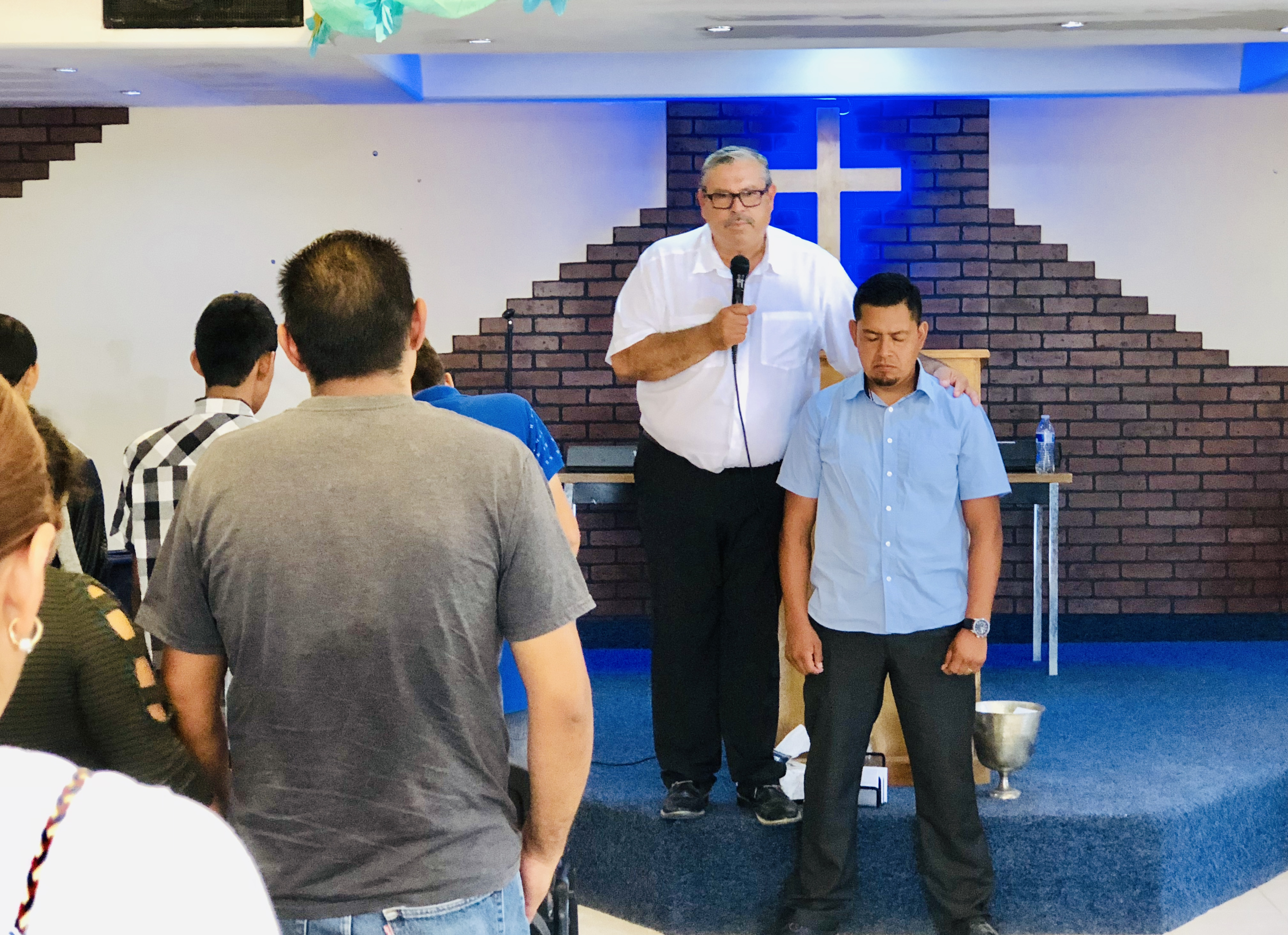 Pastor Daniel Nuñez praying for Pastor Victor