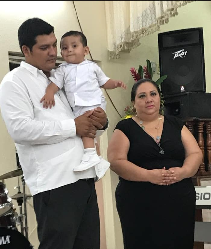 Pastor Luis with his wife, Gina and their son